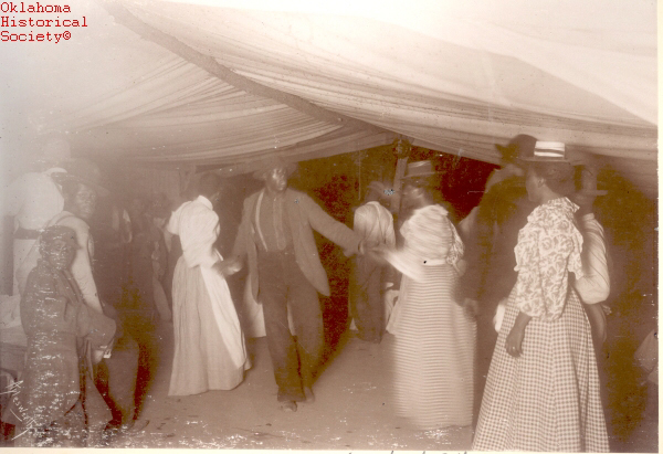 Aylesworth Album Collection. - Photographs. - Box 1. FREEDMEN DANCE DURING ENROLLMENT AT FORT GIBSON